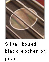 Silver bound black mother of pearl