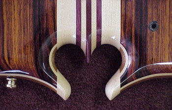heart omega carving